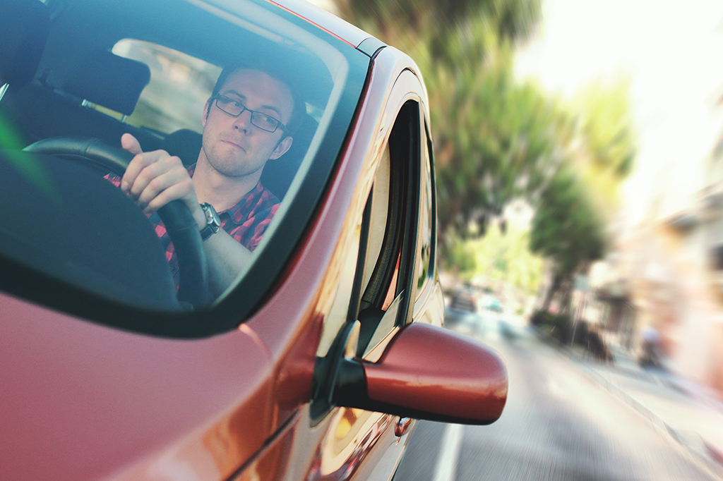 Contest a speeding ticket, civil infraction, traffic infraction, or E-DU, in Kitsap County. Image of a man driving.